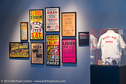 Old race posters on display in Drag Racing: America's Fast Time - exhibition at the Harley-Davidson Museum during the Milwaukee Rally. Milwaukee, WI, USA. Saturday, September 3, 2016. Photography ©2016 Michael Lichter.
