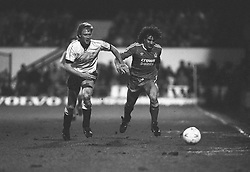 (L-R) Mark Wright, Derby, chases after Liverpool's Craig Johnston