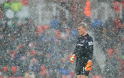 Everton goalkeeper Jordan Pickford in the snow during the Premier League match at the bet365 Stadium, Stoke.