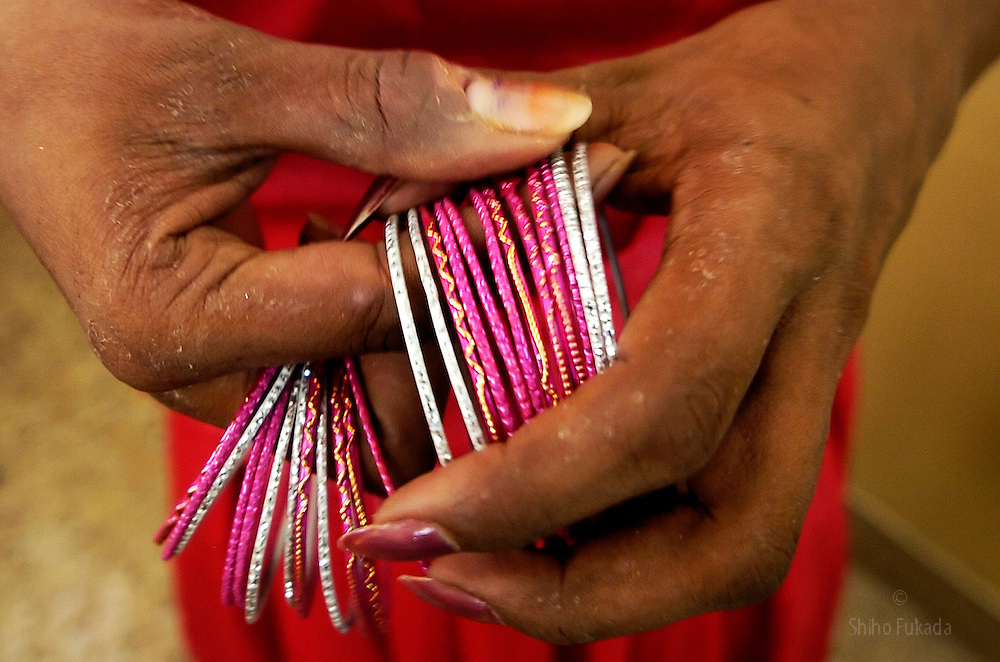 """A transgender puts on bangles in Villupuram, India. <br /> As transgenders,""""hijras"""" in local terms, are acutely marginalized in Indian society, the major earning avenues for them are sex work, begging and performing at rituals."""