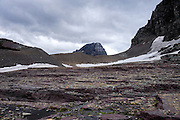 Debris left by a melting glacier and the lateral moraine marking the edge of where the glacier was with the peak of Bearhat Mountain in the distance at the base of Mount Clements at Logan Pass, Glacier National Park, Montana , Tuesday, October 7, 2014. According to Dan Fagre Ph.D. rocky debris fields are created when a glacier melts and the rocks within it are no longer suspended in ice and fall to the ground.