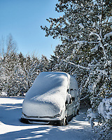 Winter part II. It snowed last night. The RV is covered and won't be going anywhere soon. The propane tank in the RV is full in case the power goes out. Image taken with a Nikon D300 camera and 18-200 mm VR lens (ISO 200, 31 mm, f/7, 1/800 sec).