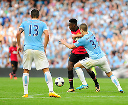 Manchester City's Matija Nastasic stops Manchester United's Danny Welbeck from progressing - Photo mandatory by-line: Dougie Allward/JMP - Tel: Mobile: 07966 386802 22/09/2013 - SPORT - FOOTBALL - City of Manchester Stadium - Manchester - Manchester City V Manchester United - Barclays Premier League
