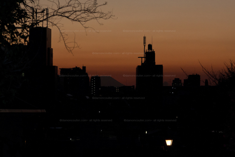 Sunset over Tokyo from Fujimizaka (Mount Fuji viewing Hill) in Nishi Nippori, Tokyo, Japan. Friday January 11th 2013. This is the last street level place in central Tokyo to see Mount Fuji and is threaten with development that will block the view of this iconic peak.