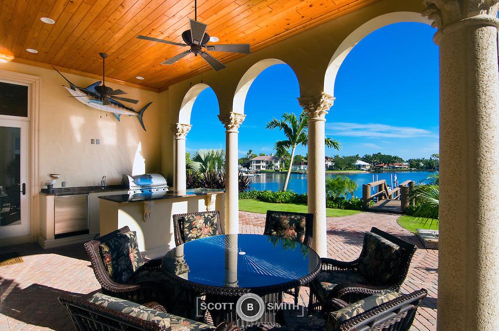 Luxury custom Florida waterfront home outdoor kitchen.