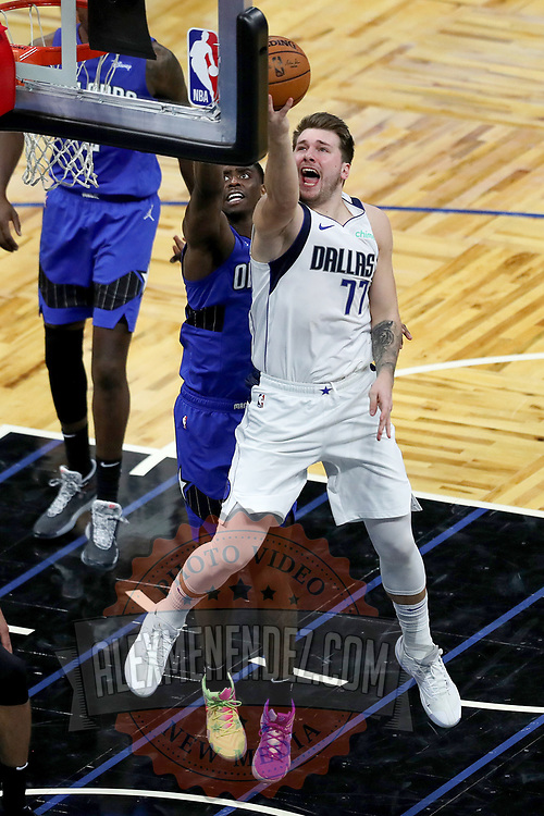 ORLANDO, FL - MARCH 01: Luka Doncic #77 of the Dallas Mavericks drives past Dwayne Bacon #8 of the Orlando Magic at Amway Center on March 1, 2021 in Orlando, Florida. NOTE TO USER: User expressly acknowledges and agrees that, by downloading and or using this photograph, User is consenting to the terms and conditions of the Getty Images License Agreement. (Photo by Alex Menendez/Getty Images)*** Local Caption *** Luka Doncic; Dwayne Bacon