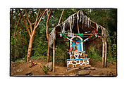 SHOT 2/9/18 5:39:01 PM - A small roadside capilla under a palapa near Chacala, Mexico. Capillas are common along the roads and highways of Mexico which is heavily Catholic and are often dedicated to certain patron saints or to the memory of a loved one that has passed away. Often times they contain prayer candles, pictures, personal artifacts or notes. (Photo by Marc Piscotty / © 2018)
