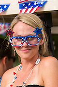 A woman wears silly patriotic sunglasses during the Daniel Island Independence Day parade July 3, 2015 in Charleston, South Carolina.