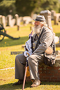 A Civil war re-enactor in period costume rests during a service at Elmwood Cemetery to mark Confederate Memorial Day May 2, 2015 in Columbia, SC. Confederate Memorial Day is a official state holiday in South Carolina and honors those that served during the Civil War.