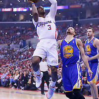 21 April 2014: Los Angeles Clippers guard Chris Paul (3) goes for the layup past Golden State Warriors guard Stephen Curry (30) during the Los Angeles Clippers 138-98 victory over the Golden State Warriors, during Game Two of the Western Conference Quarterfinals of the NBA Playoffs, at the Staples Center, Los Angeles, California, USA.