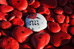 Some of the hundreds of hand-painted pebbles at the foot of the Tommy Statue in Seaham, Co Durham, where a two minutes' silence was observed to mark Armistice Day, the anniversary of the end of the First World War.