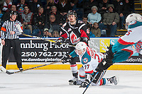 KELOWNA, CANADA - JANUARY 18: Calvin Thurkauf #27 of the Kelowna Rockets falls to the ice after being hit in the leg with the puck in front of Josh Thrower #47 of the Moose Jaw Warriors on January 18, 2017 at Prospera Place in Kelowna, British Columbia, Canada.  (Photo by Marissa Baecker/Shoot the Breeze)  *** Local Caption ***
