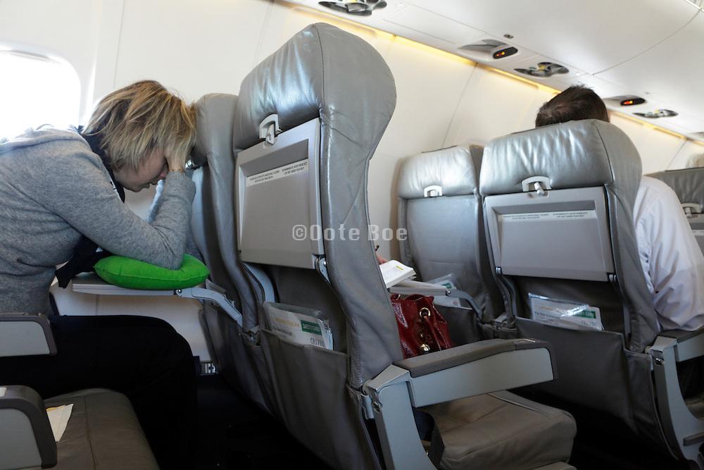 female passenger in airplane feeling unwell