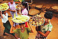 Women are selling food and serving it up to the passengers of a train in Myanmar. --- Image by © Owen Franken