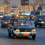 Taxi cab in heavy traffic on Cairo road, Cairo, Egypt (January 2008)