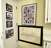 """Dollar store frames with prints of European landmarks in a corner of the kitchen. Photo taken on January 8, 2019 for """"At Home"""" feature on Sandy Stolberg, who uses dollar store finds as part of the decorations in her Belleville, IL condo.<br /> Photo by Tim Vizer"""