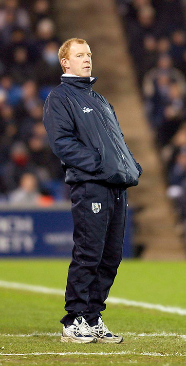 Photo. Jed Wee.<br /> West Bromwich Albion v Arsenal, Carling Cup, The Hawthorns, West Bromwich. 16/12/2003.<br /> West Bromwich manager Gary Megson watches his team go 1-0 behind to an Nwankwo Kanu goal.