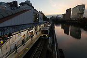 An E231-0 series train on the Chūō-Sōbu Line at Ichigaya station at dusk. Tokyo, Japan. Friday November 18th 2016