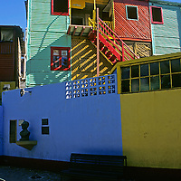 South America, Americas, Latin America, Buenos Aires, La Boca. Colorful street scene of La Boca neighborhood or barrio of Buenos Aires.