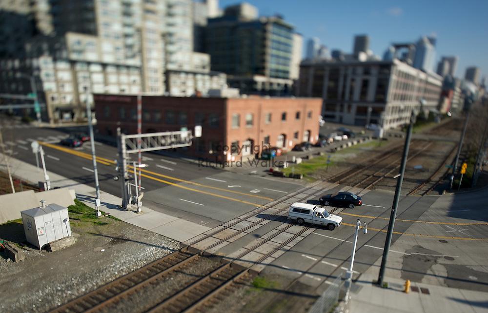 2010 FEBRUARY 09 - Cars cross the railroad tracks on Broad Street near Alaskan Way in Seattle, WA. Photographed with a tilt-shift lens. Photo by Richard Walker