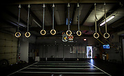 BEAUFORT, SC - JULY 14: CJ Cummings turns the light out at Cross Fit Beaufort after training with weightlifting coach Ray Jones on July 14, 2014 in Beaufort, South Carolina. Cummings is competing at the Open Men's Nationals in July.  (Photo by Stephen B. Morton for The Washington Post)