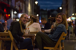 © Licensed to London News Pictures.  29/08/2021. London, UK. Revellers make the most of the Bank Holiday night out in Soho, central London. Photo credit: Marcin Nowak/LNP