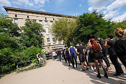 Clubbers queuing outside infamous Berghain nightclub on a Sunday afternoon in Berlin Germany - - Editorial Use Only