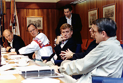 """Camp David, Maryland - August 4, 1990 -- United States President George H.W. Bush meets with national security advisors at Camp David to discuss Iraq on August 4, 1990. From left ate Secretary of Defense Richard B. """"Dick"""" Cheney; President Bush; Vice President Dan Quayle; Defense Undersecretary Paul D. Wolfowitz (standing); White house Chief of Staff John Sununu; and Central Intelligence Agency (CIA) Director William H. Webster. Photo by White House/ CNP/ABACAPRESS.COM"""