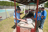 Maurice Chaloux, John Colgrove and Thaddeus Thresher make burger patties in preparation for the 70th Anniversary celebration of the Kiwanis Pool in St. Johnsbury Vermont.  Karen Bobotas / for Kiwanis International