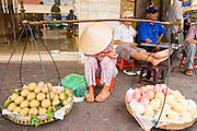 09 MARCH 2006 - HO CHI MINH CITY, VIETNAM: A woman rests while selling fruit on a street in Ho Chi Minh City (formerly Saigon), Vietnam near the Central Market. Photo by Jack Kurtz