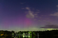 Middletown, New York - The northern lights (aurora borealis) are visible in the sky over the lake at Fancher-Davidge Park on Sept. 7,  2017.