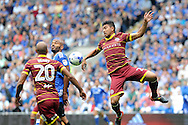 QPR's Massimo Luongo (r) heads away from Cardiff City's Frederic Gounongbe. EFL Skybet championship match, Cardiff city v Queens Park Rangers at the Cardiff city stadium in Cardiff, South Wales on Sunday 14th August 2016.<br /> pic by Carl Robertson, Andrew Orchard sports photography.