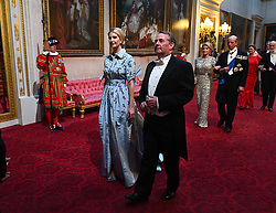 Ivanka Trump and Secretary of State for International Trade, Liam Fox arrive through the East Gallery during the State Banquet at Buckingham Palace, London, on day one of the US President's three day state visit to the UK.