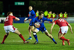 Giulio Bertaccini of Italy evades the tackle of Sam Costelow of Wales <br /> <br /> Photographer Craig Thomas/Replay Images<br /> <br /> U20 Six Nations - Wales v Italy  - Friday 31st January 2020 - Stadiwm Zip World (Parc Eirias) - Colwyn Bay<br /> <br /> World Copyright © Replay Images . All rights reserved. info@replayimages.co.uk - http://replayimages.co.uk