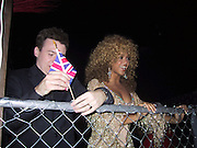 "Mike Myers & Beyonce Knowles inside the caged VIP Area.EXCLUSIVE.""Austin Powers"" Post Premiere Party.Universal Studios.Hollywood, CA.July 22, 2002.Photo By Celebrityvibe.com.."