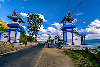 Indonesia, Sumatra. Parapat. Parapat is a popular resort town for Indonesians.  It is the primary ferry port to Samosir Island. You will pass this gate if you come from Medan.