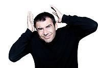 caucasian man portrait afraid shielding protecting his head portrait on studio isolated white background