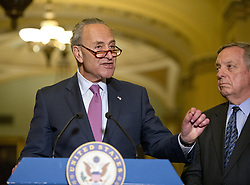 June 27, 2017 - Washington, District of Columbia, United States of America - United States Senate Minority Leader Chuck Schumer (Democrat of New York) speaks to reporters following the Democratic Party luncheon in the United States Capitol in Washington, DC on Tuesday, June 27, 2017.  At right is US Senate Minority Whip Dick Durbin (Democrat of Illinois)..Credit: Ron Sachs / CNP (Credit Image: © Ron Sachs/CNP via ZUMA Wire)