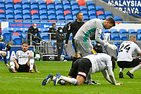 Football - 2020 / 2021 Sky Bet Championship - Cardiff City vs Rotherham United - Cardiff city Stadium<br /> <br /> Angus MacDonald Rotherham United, -left- Matt Crooks , Rotherham United  is patted on the back by Jamal Blackman Rotherham United & Michael Smith Rotherham United look <br /> fall to the floor after the final whistle .<br /> COLORSPORT/WINSTON BYNORTH