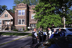 June 1, 2017 - Chicago, IL, USA - Chicago police investigate the scene of a shooting near 59th and South Peoria streets in the Englewood neighborhood on June 1, 2017 in Chicago. (Credit Image: © Chris Sweda/TNS via ZUMA Wire)