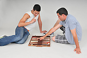 Two middle eastern men playing backgammon