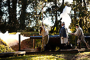 Costumed re-enactors fire a 17th century cannon along the fortifications of historic Charles Towne Landing, the original settlement of Charleston, SC where English settlers established the city in 1670. The site is now a state park and historic site.