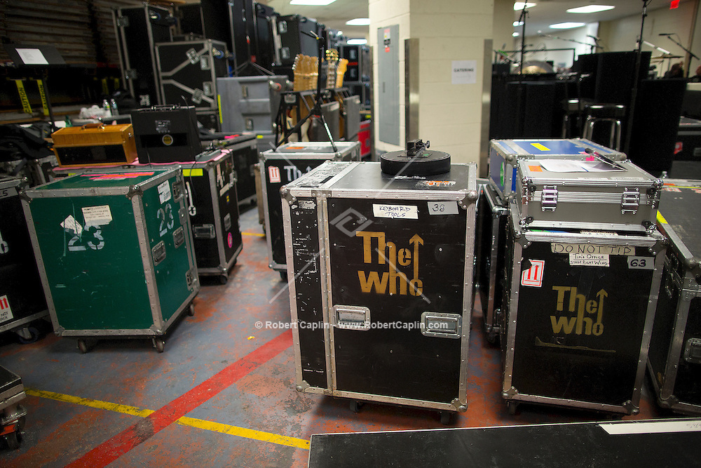 """Road Cases and equipment backstage. """"12-12-12?, a fundraising concert to aid the victims of Hurricane Sandy, will take place on December 12, 2012 at Madison Square Garden. The concert featured The Rolling Stones, Bon Jovi, Eric Clapton, Dave Grohl, Billy Joel, Alicia Keys, Chris Martin, Bruce Springsteen & the E Street Band, Eddie Vedder, Roger Waters, Kanye West, The Who, and Paul McCartney. All the proceeds went go to the Robin Hood Relief Fund. Robin Hood, the largest independent poverty fighting organization in the New York area, will insure that every cent raised will go to non-profit groups that are helping the tens of thousands.of people throughout the tri-state area who have been affected by Hurricane Sandy...Photo © Robert Caplin.."""