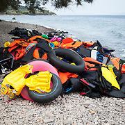 Discarded lifejackets on the beach of Skala Sykamias on the northern shores of Lesvos, Greece.