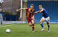 Luke Hendrie of Bradford City takes the ball past Charlie Wakefield of Chesterfield during the EFL Trophy match between Chesterfield and Bradford City at the b2net stadium, Chesterfield, England on 29 August 2017. Photo by Paul Thompson.