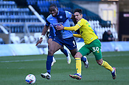 Norwich City defender (on loan from PAOK) Dimitris Giannoulis (30) battles for possession  with Wycombe Wanderers forward Uche Ikpeazu (9) during the EFL Sky Bet Championship match between Wycombe Wanderers and Norwich City at Adams Park, High Wycombe, England on 28 February 2021.