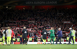 FC Koln players applaud their fans after the final whistle of the Europa League match at the Emirates Stadium, London.