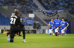 Brighton and Hove Albion's Danny Welbeck and players take a knee prior to kick-off during the Premier League match at the American Express Community Stadium, Brighton. Picture date: Saturday May 15, 2021.