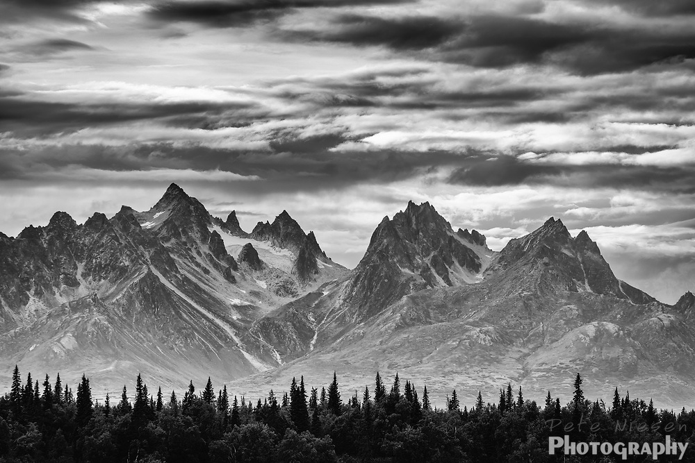 Black and white of the sharp peaks and glaciers of the Alaska Range Mountains