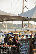 People on a esplanade at the Docks area in Lisbon. The docks were transformed into a restaurant and bars area some years ago.